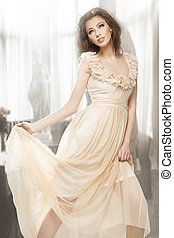 Sexy brunette posing in a gorgeous dress