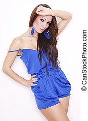 Sexy brunette posing in blue dress.