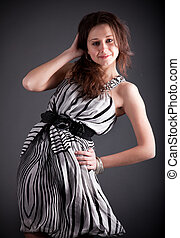 Sexy brunette with dress and hair lifted by wind at studio -...