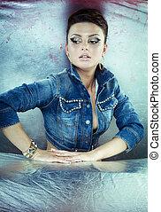 Sexy brunette woman in denim jacket