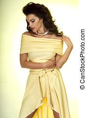 Sexy brunette woman in dress.