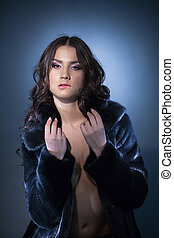 Sexy brunette woman in fur coat