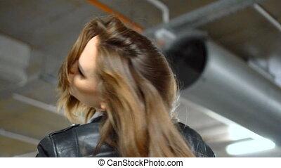 Sexy brunette woman in garage