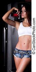 Sexy brunette woman in gymnasium