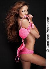 Sexy brunette woman in lingerie posing.
