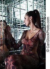 Sexy brunette woman in nightclub