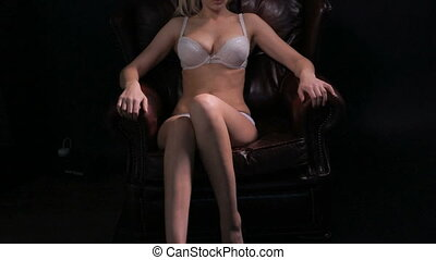 sexy brunette woman on the chair