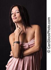 Sexy brunette woman posing in dress