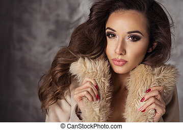 Sexy brunette woman posing in lingerie and coat