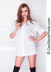 sexy brunette woman wearing just white mens shirt