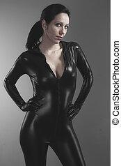 Sexy, brunette woman wearing latex Length