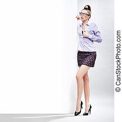Sexy businesswoman next to the white board