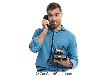 casual man talking on an retro telephone