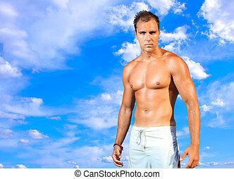 man posing in a beach