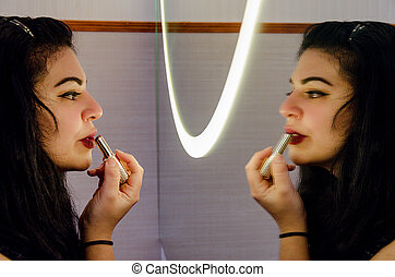 Sexy chubby woman painting her lips with a blusher