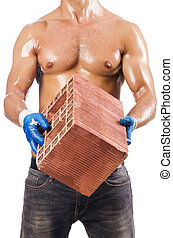 Sexy construction worker with bricks