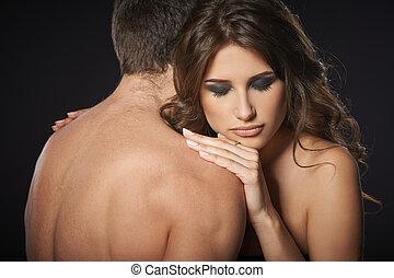 sexy, coppia, giovane, abbracciare