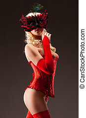 Sexy corseted woman in mask