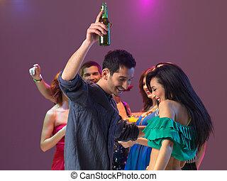 sexy couple dancing in night club