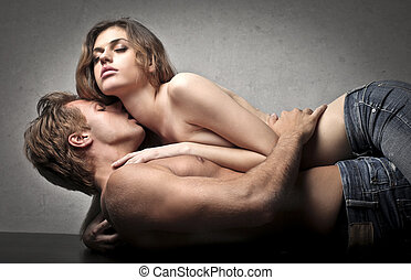 sexy couple - lovers kissing on gray background
