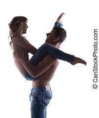 Sexy couple posing topless in jeans silhouette isolated