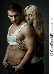 sexy couple - muscular handsome sexy guy with pretty woman...