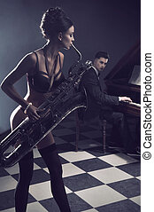 Sexy couple with instruments