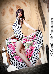 Sexy cute woman in elegant dress