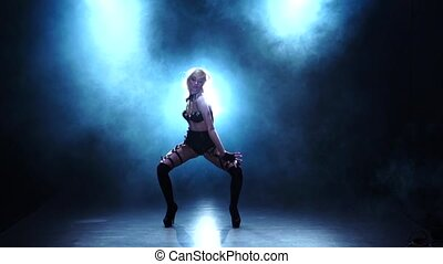 Sexy dancer demonstrating her perfect figure. Smoky studio, slow motion