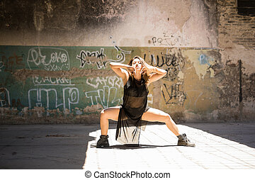 Sexy dancer performing outdoors