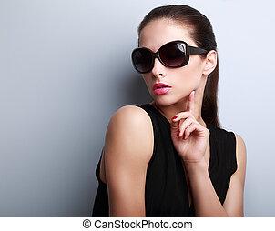 Sexy elegant beautiful female model in fashion sunglasses posing