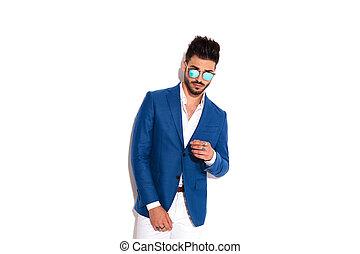 sexy elegant man wearing sunglasses posing