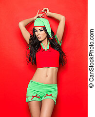 Sexy Elf - Beautiful and sexy woman wearing christmas elf...