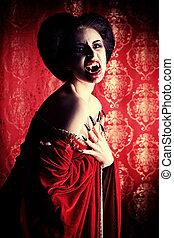 sexy evil - Portrait of a bloodthirsty female vampire over...
