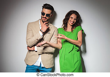 sexy fashion woman laughing while pointing at her man ,