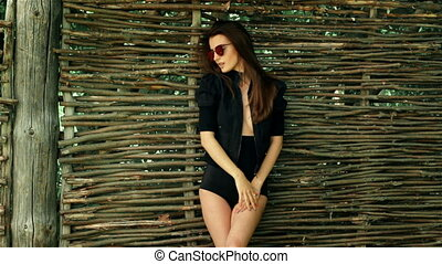 sexy fashionable lady with glasses and black body with...
