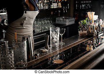 Sexy female barman with decolletage standing behind the bar...