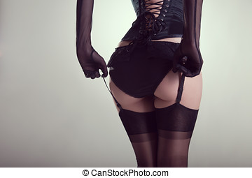 Sexy female buttocks in burlesque lingerie