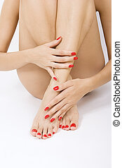 female foot with red pedicure - - red manicure and pedicure
