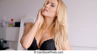 Sexy Female in Black Bra Looking at the Camera