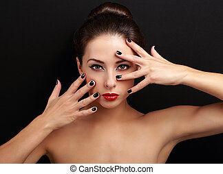 Sexy female model showing manicured hands near the makeup face