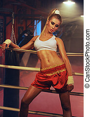sexy fit blonde woman in boxing ring