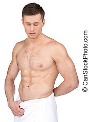 Sexy fit nude man in white towel. Standing isolated over...