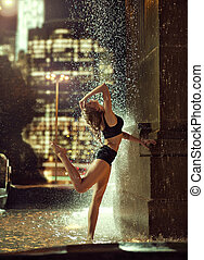 Sexy, fit woman in a fountain
