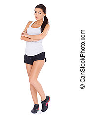 Sexy fitness woman posing on white
