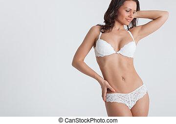 sexy, frau, in, a, weißes, damenunterwäsche, auf, der, hintergrund