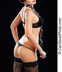 sexy, frau, in, erotisch, damenunterwäsche, aus, dunkler hintergrund