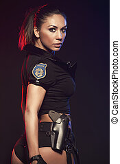 sexy, frau, mit, polizeiuniform, in, studio, auf, dunkel,...