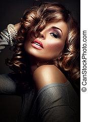 Sexy girl. Beauty model posing over dark background