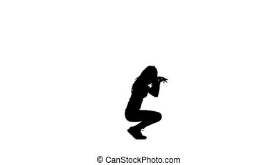 Sexy girl dancer dancing jazz-funk vogueing on white background, slow motion, silhouette